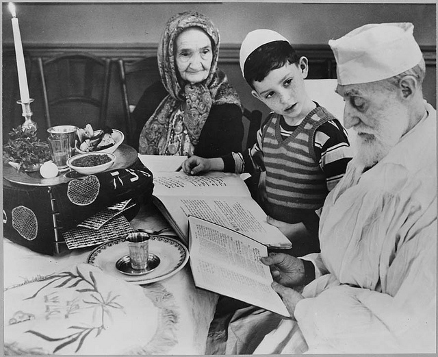 Photograph of a Young Jewish Boy with Elders at a Passover Ceremony, 04/16/1951